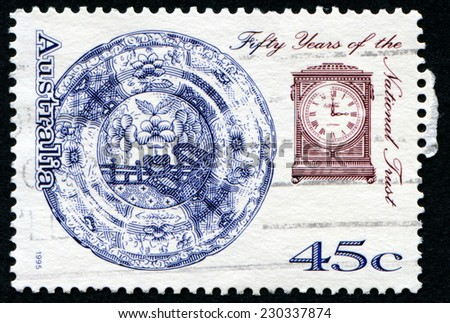 AUSTRALIA - CIRCA 1995: A pair of postage stamp printed in Australia with image of  cutlery wares and clock to commemorate the fifty years of the Australian National Trust. - stock photo