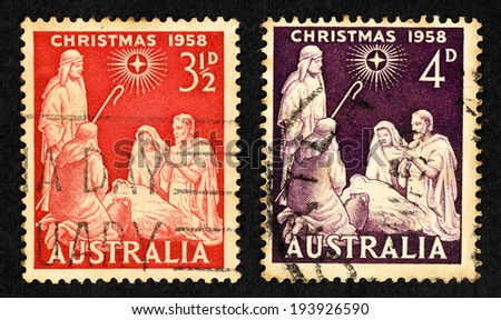 AUSTRALIA - CIRCA 1958: A pair of postage stamp printed in Australia with image of the Nativity of baby Jesus with the three Wiseman for Christmas series. - stock photo