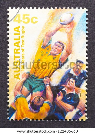 AUSTRALIA-Â?Â? CIRCA 1999: A postage stamp printed in Australia showing an image commemorative of 100 years of rugby, circa 1999. - stock photo