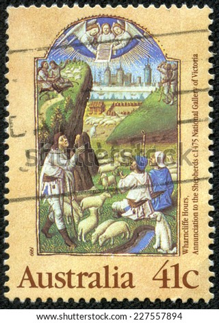 "AUSTRALIA - CIRCA 1989: A stamp printed in Australia from the ""Christmas. Illuminated Manuscripts "" issue shows Annunciation to the Shepherds (Wharncliffe Book of Hours, c. 1475), circa 1989. - stock photo"