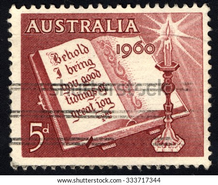 AUSTRALIA - CIRCA 1960: A stamp printed in Australia from the Christmas issue shows Open Bible and Candle, circa 1960 - stock photo