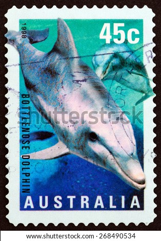 "AUSTRALIA - CIRCA 1998: A stamp printed in Australia from the ""Marine Life "" issue shows Bottlenose Dolphin (Tursiops truncatus), circa 1998. - stock photo"