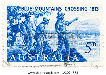 AUSTRALIA - CIRCA 1963: A stamp printed in Australia shows Explorers Blaxland, Lawson and Wentworth Looking West from Mt. York, circa 1963 - stock photo