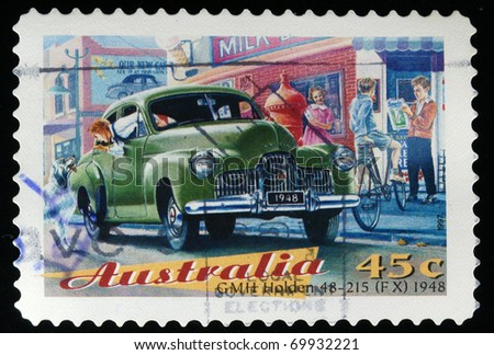 AUSTRALIA - CIRCA 1997: A stamp printed in Australia shows GMH Holden 48-125 FX 1948, circa 1997 - stock photo
