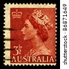 AUSTRALIA-CIRCA 1953:A stamp printed in Australia shows image of Elizabeth II (Elizabeth Alexandra Mary, born 21 April 1926) is the constitutional monarch of United Kingdom, circa 1953. - stock photo