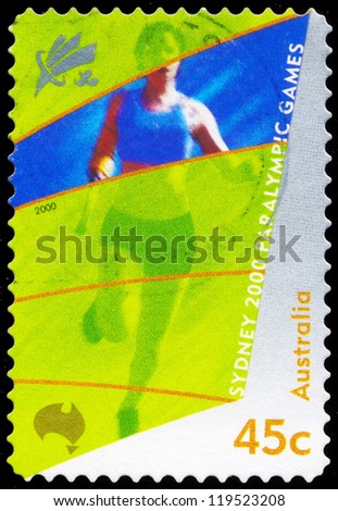AUSTRALIA - CIRCA 2000: A stamp printed in AUSTRALIA shows the Amputee running, 2000 Paralympics, Sydney, series, circa 2000 - stock photo