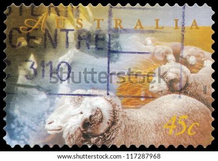 AUSTRALIA - CIRCA 1998: A Stamp printed in AUSTRALIA shows the Sheep for producing wool, Farming series, circa 1998 - stock photo
