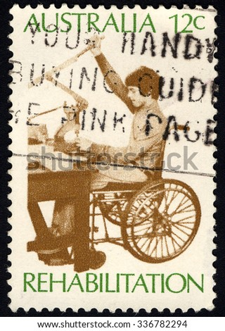 AUSTRALIA - CIRCA 1972: A stamp printed in Australia shows the Worker in Sheltered Workshop, Rehabilitation of the Handicapped series, circa 1972 - stock photo