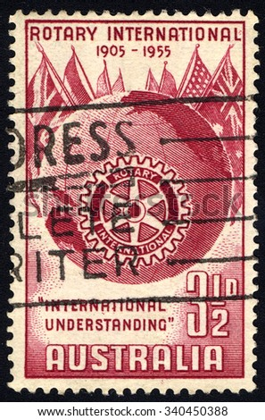 AUSTRALIA - CIRCA 1955: A stamp printed in Australia to commemorate 50 Years of Rotary International shows Rotary Symbol, Globe and Flags, circa 1955