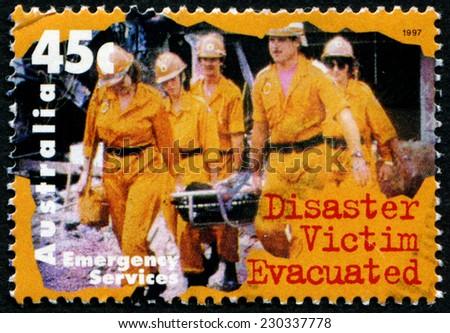 AUSTRALIA - CIRCA 1997: a stamp printed in the Australia shows Disaster Victim Evacuated, circa 1997 - stock photo