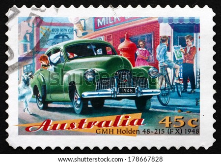 AUSTRALIA - CIRCA 1997: a stamp printed in the Australia shows GMH Holden 48-215 (FX), Classic Car from 1948 - stock photo