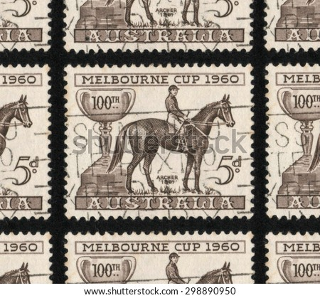 """AUSTRALIA - CIRCA 1960: A used postage stamp printed in Australia from """"The 100th Anniversary of the Melbourne Cup"""" issue, showing the Melbourne cup, a racehorse and jockey. - stock photo"""