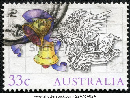 AUSTRALIA - CIRCA 1985: Postage stamp printed in Australia, Christmas Issue, shows Illustrations by Scott Hartshorne, Angel with bells, circa 1985 - stock photo