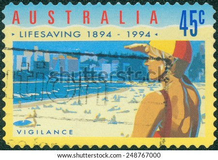 AUSTRALIA - CIRCA 1994: Postage stamp printed in Australia, dedicated to the 100th anniversary of the Royal Life Saving Society, shows Vigilance, circa 1994 - stock photo
