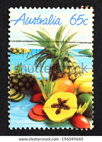 AUSTRALIA - CIRCA 1987: Postage stamp printed in Australia with colorful image of tropical fruits, pineapple, papaya and mango.  - stock photo