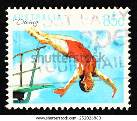 AUSTRALIA - CIRCA 1991: Postage stamp printed in Australia with image of a female springboard diver sportswoman. - stock photo