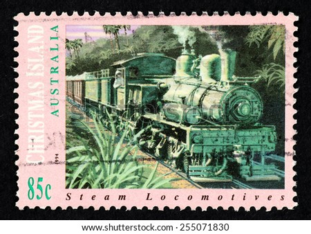 AUSTRALIA - CIRCA 1994: Postage stamp printed in Australia with image of a steam locomotive train through the Christmas Island jungle. - stock photo