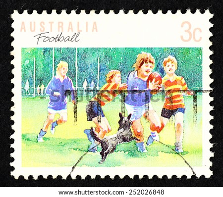 AUSTRALIA - CIRCA 1989: Postage stamp printed in Australia with image of Aussie Rule football players. - stock photo