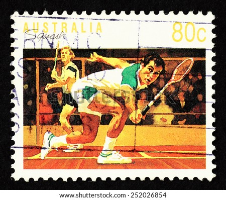 AUSTRALIA - CIRCA 1991: Postage stamp printed in Australia with image of male squash player in a squash court.  - stock photo