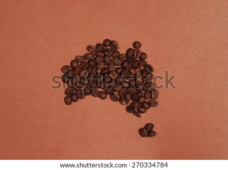 Australia continent map made of coffee beans on brown background - stock photo