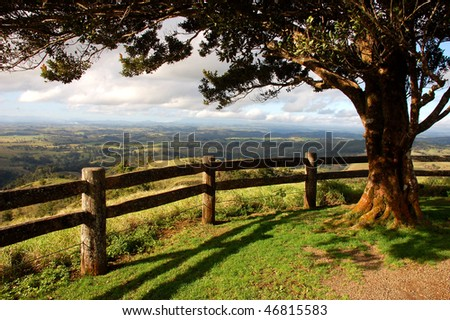 Australia countryside from a lookout with tree and fence - stock photo