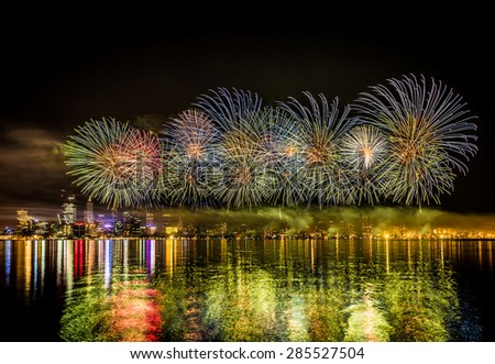 Australia Day, celebration, green fire works over the Swan river, with Perth City in the background - stock photo