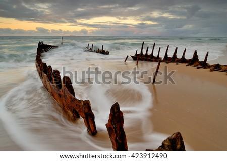 Australia Landscape : Dicky Beach and shipwreck - stock photo