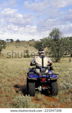 AUSTRALIA - MAY 6: Gold miner in the Australian outback starting quad explore the area with his metal detector, may 6, 2007. - stock photo