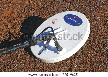 AUSTRALIA - MAY 17: hard metal detector on a background of mineralized soil is often where gold nuggets, may 17, 2007 - stock photo
