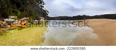australia NSW sacred land billabong in national park sand flat outback and rocks covered with gum trees traditional lifestyle - stock photo