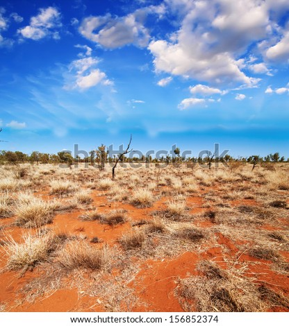 Australia, Outback landscape. Beautiful colors of earth and sky. - stock photo