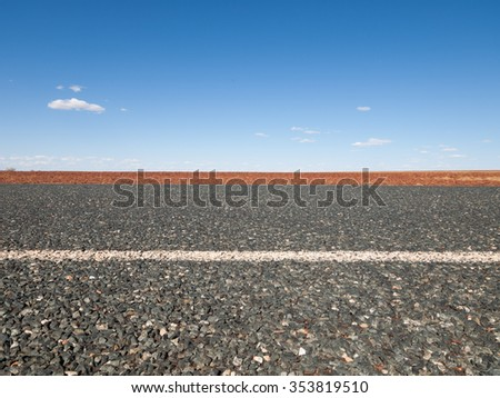 Australia, Outback, 09/10/2015, Long outback australian road with a beautiful blue sky  - stock photo