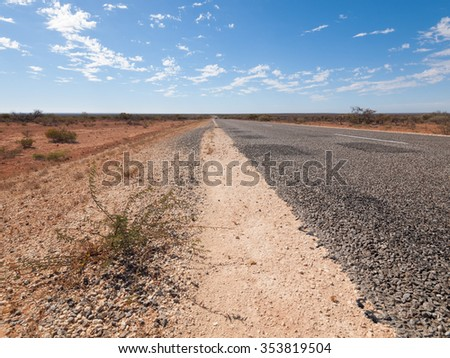 Australia, Outback, 09/10/2015, Long outback australian road with a beautiful blue sky disappearing into the horizon - stock photo