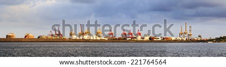 australia sydney botany bay cargo port panoramic view with cranes, containers, derricks and heavy dock equipment in a waterfront - stock photo