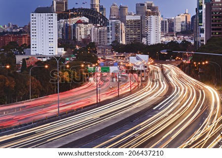 Australia Sydney cahill expressway highly congested motorway towards city CBD at sunset with illuminated vehicle lights rush hour blurred lights - stock photo