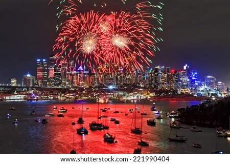 australia sydney city CBD close view at new year firewalls with red balls hanging over skyscrapers and reflecting in harbour water - stock photo