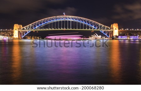 australia Sydney city CBD landmarks illuminated by Vivid Light show projection of lights and reflection in harbour waters - stock photo