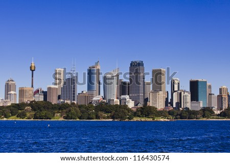 Australia Sydney City CBD sunny day view from harbour ferry summer blue sky and harbor water cityline - stock photo