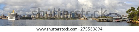 Australia, Sydney cityscape panorama of CBD and Harbour bridge with main landmarks on a sunny day in panoramic view across Sydney harbour waters