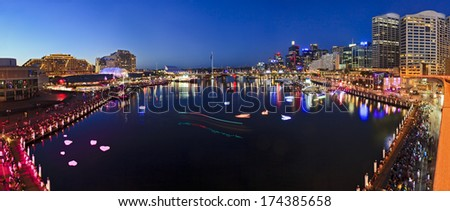 Australia Sydney Darling harbour still blurred water of coockle bay at sunset with illuminated buildings, hotels and tourism attractions - stock photo