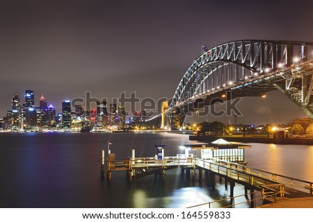australia sydney landmarks sunset view over harbour bright illuminated buildings of city CBD and arch of harbour bridge
