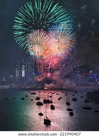 Australia SYdney New Year fireworks green color light balls over city CBD skyscrapers reflecting in harbour water