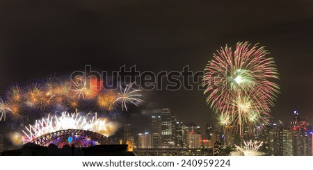 Australia Sydney New Year FIreworks over city CBD skyscrapers and harbour bridge panoramic view