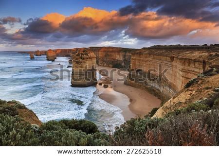 Australia victoria Great Ocean road national park - natural landmark of 6 out of 12 sandstone apostles at sunrise - stock photo