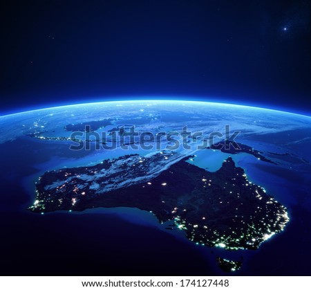 Australia with city lights from space at night - Earth daytime series (Elements of this 3d image furnished by NASA) - stock photo