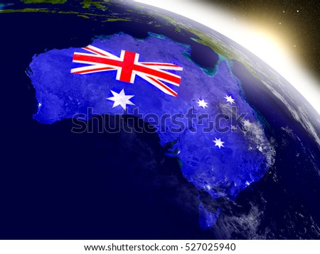 Australia with embedded flag on planet surface during sunrise. 3D illustration with highly detailed realistic planet surface and visible city lights. Elements of this image furnished by NASA.