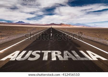 Australia written on desert road - stock photo