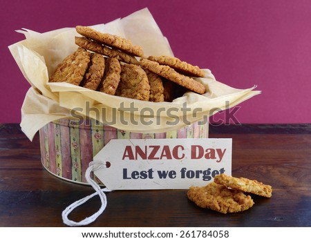 Australian Anzac biscuits in vintage biscuit tin container with Lest We Forget message. - stock photo