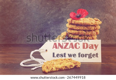 Australian Anzac biscuits with Anzac Day, Lest We Forget message on dark wood and slate background with applied retro vintage filters and added light effects. - stock photo