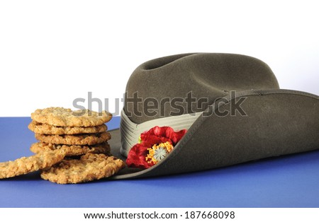 Australian army slouch hat and traditional Anzac biscuits on white and blue background for Anzac Day, April 25, or Remembrance Armistice Day, November 11. - stock photo